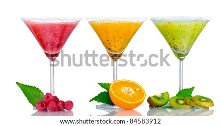Delicious fruit smoothies and fruit isolated on white - stock photo