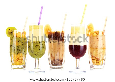 Delicious fruit smoothies isolated on white - stock photo