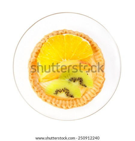 Delicious fruit tart cake on a saucer, top view, isolated with clipping path - stock photo