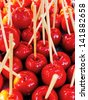 Delicious glazed apples on sticks candy apple - stock photo