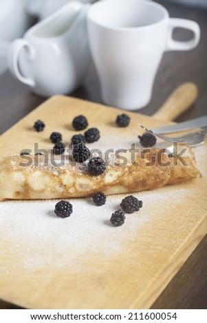 Delicious golden pancakes with fresh blackberries  - stock photo