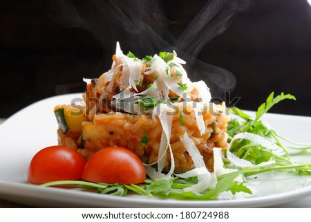 Delicious gourmet risotto with seafood, zucchinis and parsley  - stock photo
