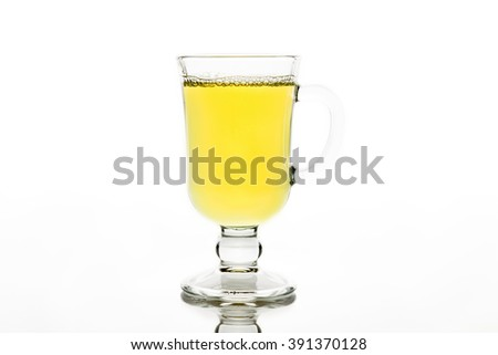 delicious green tea in a transparent cup on a white background isolated - stock photo