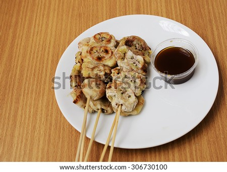 Delicious grilled banana with sweet taste sauce - stock photo