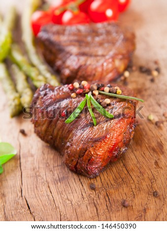 Delicious grilled beef steaks on wood