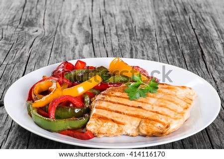 Delicious Grilled Chicken breast fillet and fried bell pepper , clos- up - stock photo