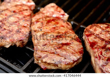 delicious grilled rump steak on barbecue - stock photo