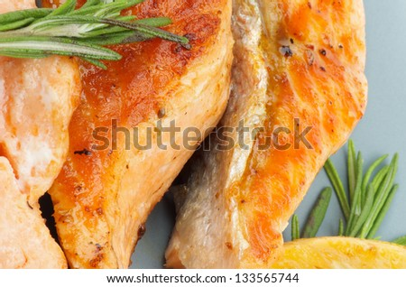Delicious Grilled Salmon closeup on Green Plate