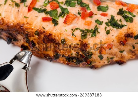 Delicious grilled salmon fillet. Macro. Can be used as a whole background.