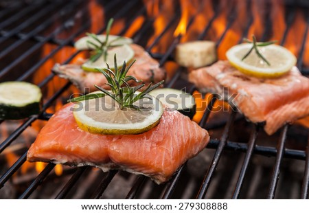 Delicious grilled salmon steaks on fire - stock photo