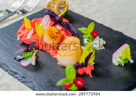 Delicious grilled scalops served with vegetables - stock photo