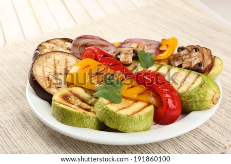 Delicious grilled vegetables on plate on table close-up - stock photo