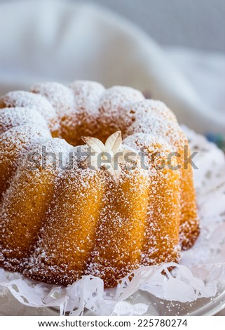 Delicious gugelhupf with gumpaste flower. Selective focus. - stock photo