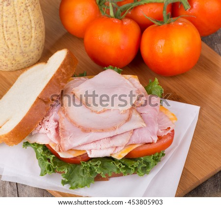 Delicious ham sandwich with lettuce, tomato and cheese