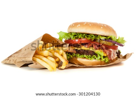 Delicious hamburger and french fries on wooden background - stock photo