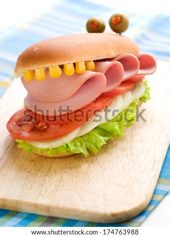 Delicious hamburger like a crocodile for kids party, selective focus  - stock photo