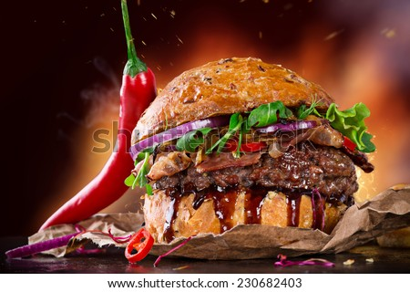Delicious hamburger on dark background