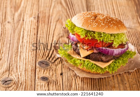 Delicious hamburger on wooden planks