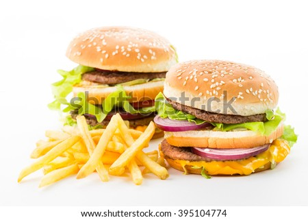 delicious hamburger, potatoes and vegetables isolated on white