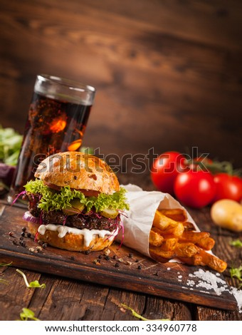 Delicious hamburger served on wooden planks