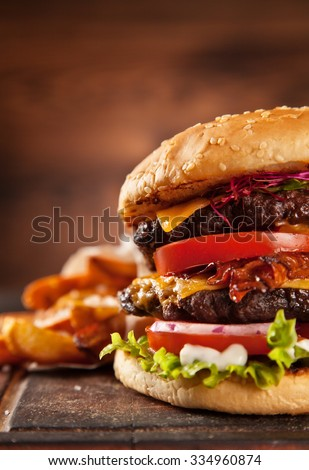 Delicious hamburger served on wooden planks - stock photo