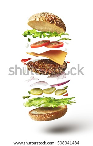 Delicious hamburger with flying ingredients on white background