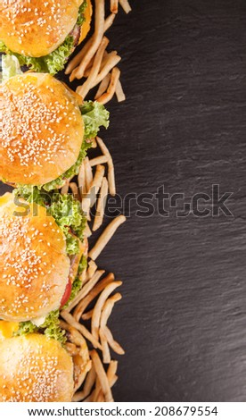 Delicious hamburgers served on black stone, shot from upper view - stock photo