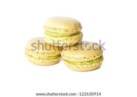 delicious handcrafted mini green tea white chocolate macaroons pyramid arrangement with white background