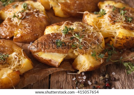 Delicious healthy baked hot potatoes with thyme close-up on the table. horizontal - stock photo