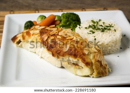 Delicious healthy grilled fish fillet served on a platter with a colorful fresh salad for a tasty seafood dinner - stock photo