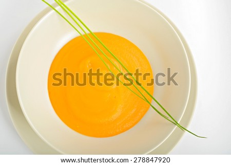 Delicious healthy pumpkin soup in a light dish. View from above, macro - stock photo