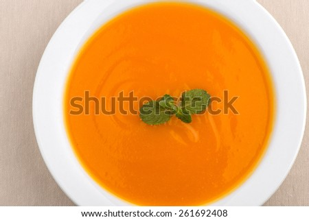 Delicious, healthy pumpkin soup in a white dish - stock photo
