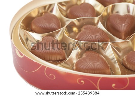 Delicious heart-shaped chocolate candies isolated - stock photo