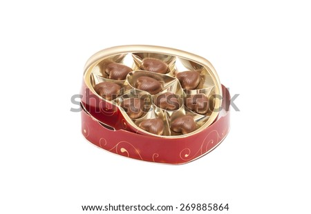 Delicious heart-shaped chocolate candies isolated on white - stock photo