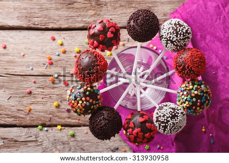 Delicious holiday colored cake pops in a glass. horizontal top view