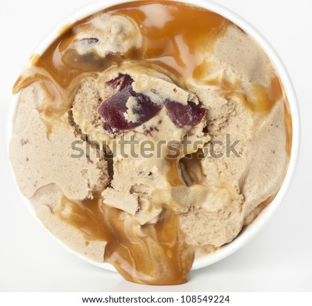 Delicious, home made creamy ice cream with cherries and caramel - stock photo