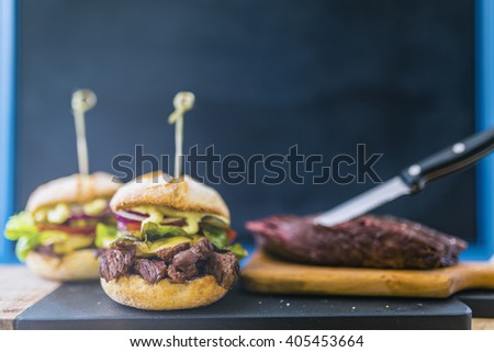 Delicious homemade burger with fresh vegetables. - stock photo