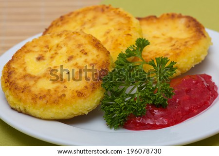 Delicious homemade cheese pancakes and berry jam, close up - stock photo