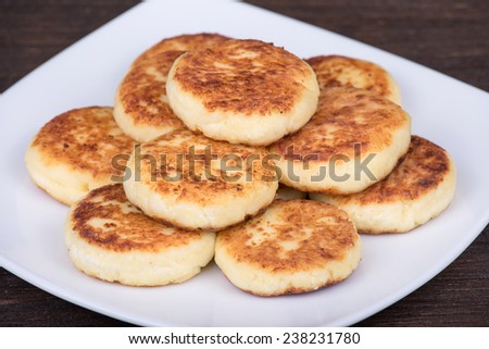 Delicious homemade cheese pancakes in white plate - stock photo