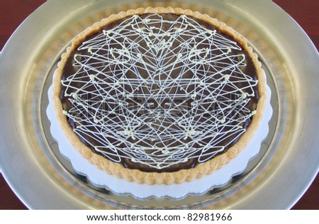 Delicious Homemade Chocolate Tart Dessert on silver platter - stock photo