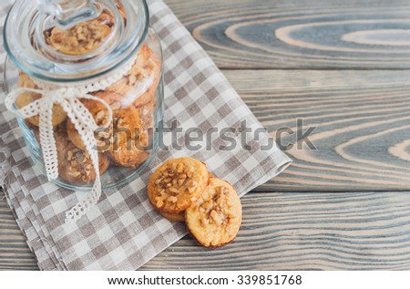 Delicious homemade cookies with walnuts on wooden background. - stock photo