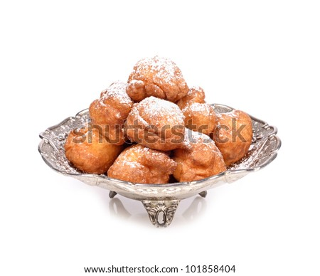 Delicious homemade fritters old antique silver metal container  isolated on white - stock photo