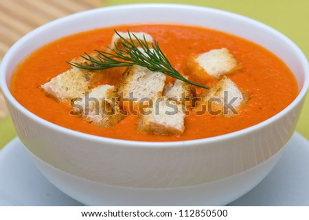 Delicious homemade gazpacho in white bowl - stock photo