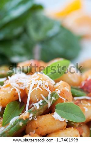 Delicious homemade gnocchi with fresh garden greens - stock photo