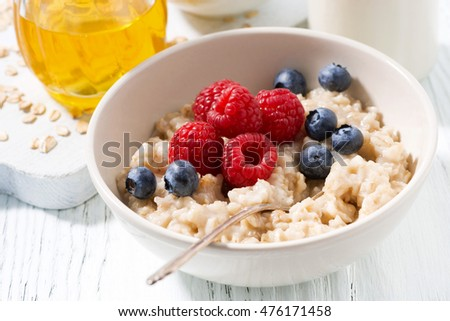 delicious homemade oatmeal with berries for breakfast, closeup, horizontal