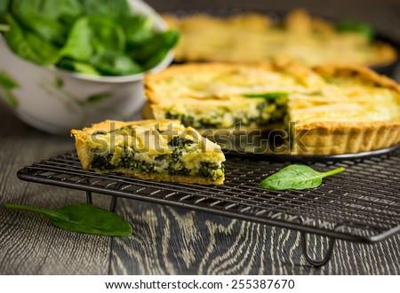 Delicious homemade spinach quiche  - stock photo