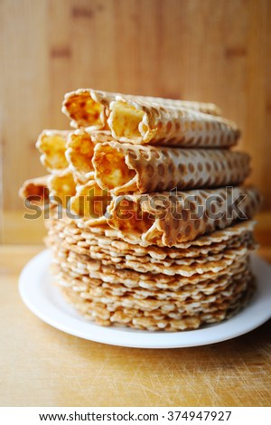 delicious homemade waffles on a white plate on a wooden background