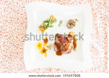 delicious hot filet with asparagus and red sauce - stock photo