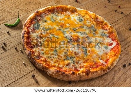 Delicious hot pizza Margarita on wooden table ready to eat - stock photo