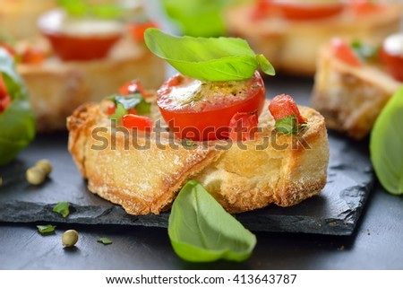 hot starters: Crispy baked crostini with tomato, mozzarella, olive oil ...